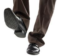 Shoes and legs of businessman caution step - stock photo