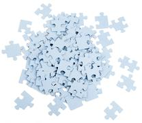 Pile of grey blank puzzle pieces - stock photo