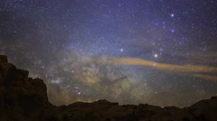 Astro Time Lapse of Milky Way over Desert Landscape in Valley of Fire -Zoom Out- Stock Footage