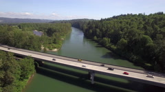 Aerial of Commuters Driving on Rural Freeway Over River in Pacific Northwest. Stock Footage