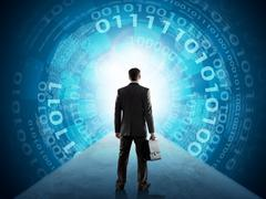 Businessman standing in front of matrix background - stock photo