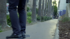 Business man travels away on skateboard in real time HD - stock footage
