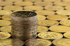 British pound coins in a neat stack. Stock Photos