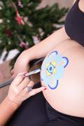 Mandala Belly Painting in Christmas - stock photo