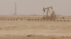 Oil Pump Jack Rocking With Pipeline Stock Footage