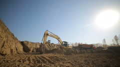 Excavator loading sand into a truck 4 Stock Footage