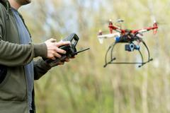 Man controling a drone - stock photo