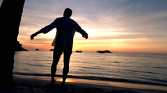 Young man admire and enjoying sunset on beach, super slow motion 120fps - stock footage