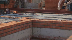 bricklayer laying bricks to make a wall 7 - stock footage