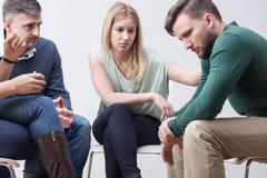 People supporting each other on psychotherapy session - stock photo
