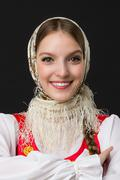 beautiful  smiling caucasian girl in russian folk costume - stock photo