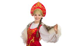 beautiful  smiling russian girl in folk costume - stock photo