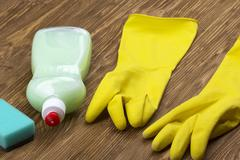 Detergent,sponge  and latex gloves - stock photo