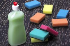 sponges and a bottle of detergent - stock photo