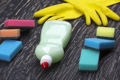 Detergent,sponges  and latex gloves - stock photo