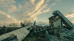 The wreckage of the building at sunset - stock footage