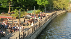 Evening sun. People sitting at Spree river cafe in Berlin. Stock Footage