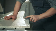 Man working with sandpaper Stock Footage