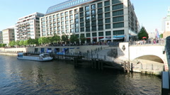 People sitting in the evening sun at Spree river cafe in Berlin. Stock Footage