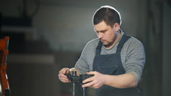 Carpenter working in studio Stock Footage