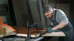 Man polishing wood with electrical sanding machine Stock Footage