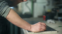Man working with a hammer Stock Footage