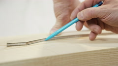 4K Close up on hands drawing a template on wood in a carpenter's workshop Stock Footage