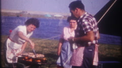 3330 flames rising from the grill at family barbecue - vintage film home movie - stock footage