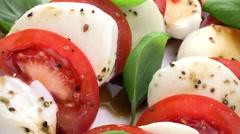 Rotating Tomato Mozzarella Salad (not loopable; 4K) Stock Footage