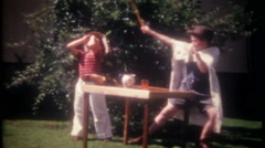 Young boys perform a magic show in the back yard - 3331 vintage film home movie Stock Footage