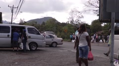 People packing bags into a truck outside of a food drive in Panama Stock Footage