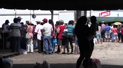 A line of people waiting to receive food at a food drive (1) Stock Footage