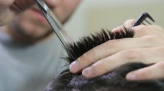 Man hairdresser doing haircut in hair salon - stock footage