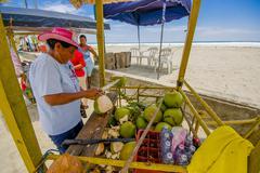 Muisne, Ecuador - March 16, 2016: Local street vendor working and using knife on Stock Photos