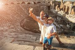 Family vacation selfie photo in anyique amphitheater in Side,Turkey Stock Photos