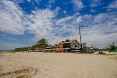 Muisne, Ecuador - March 16, 2016: Large beautiful untouched sandy beach by - stock photo