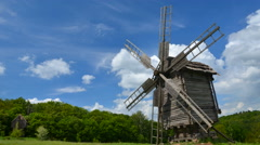 Old windmill and floating clouds Stock Footage