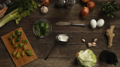 Cabbage, garlic and onions on old wooden table Stock Footage