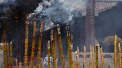 Smoking incense in the background entrance to a Buddhist temple Stock Footage
