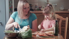 Daughter and mother chop cabbage Stock Footage