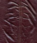 Texture of dark red natural leather Stock Photos