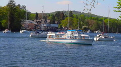 Passenger boat leaving Fell Foot for a sail up Lake Windermere, Cumbria, UK Stock Footage