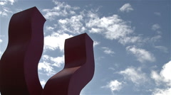 Red sculpture with sky time-lapse. Stock Footage