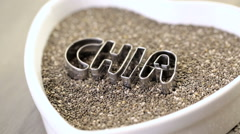 Healthy Chia seeds in a heart shaped bowl on a white background. Stock Footage
