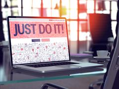 Just Do It on Laptop in Modern Workplace Background - stock illustration