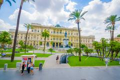ROME, ITALY - JUNE 13, 2015: Frontal view of justice palace in Rome, palms in - stock photo
