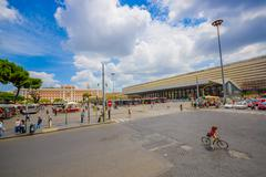 ROME, ITALY - JUNE 13, 2015: Modern bus station at Rome, people walking around Stock Photos