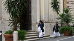 Nuns walking down the street in beautiful Rome Italy Stock Footage