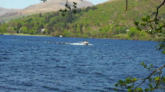 Small boat taking in a tour of Lake Windermere, Claife, Cumbria, UK Stock Footage