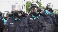Riot Police in Full Combat Gear Confront Protesters Shields Body Armor 9680 - stock footage